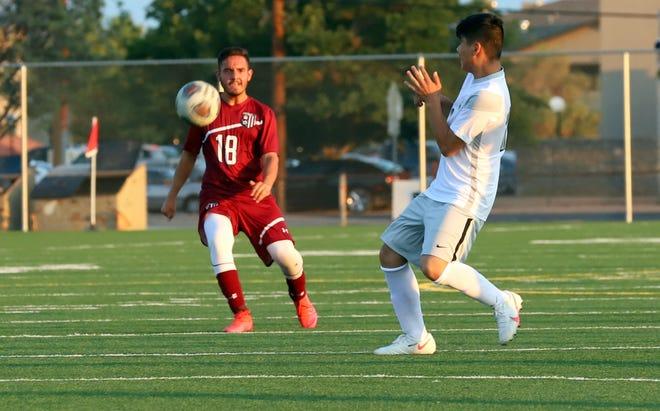 Senior David Villagrana (18) provides pressure at midfield and a push toward the Deming goal.