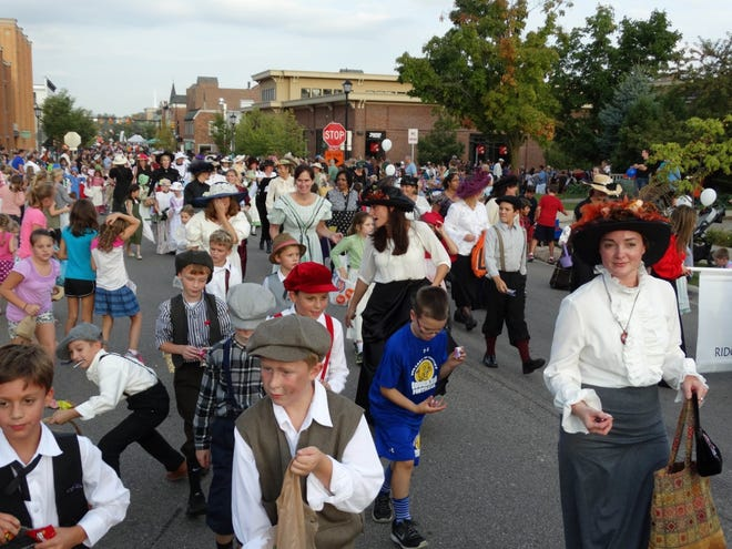 People walk through the streets of downtown Northville during a pre-COVID-19 Heritage Festival. The event returns to Northville Sept. 17-19 following a one-year absence.