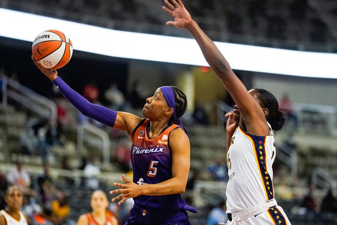 Phoenix Mercury guard Shey Peddy (5) shoots in front of Indiana Fever forward Teaira McCowan (15) in the first half of a WNBA basketball game in Indianapolis, Monday, Sept. 6, 2021. (AP Photo/Michael Conroy)