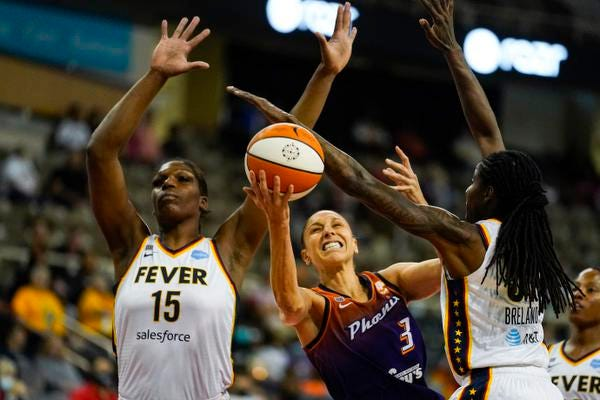 Phoenix Mercury guard Diana Taurasi (3) is fouled as she shoots between Indiana Fever forward Teaira McCowan (15) and forward Jessica Breland (51) in the first half of a WNBA basketball game in Indianapolis, Monday, Sept. 6, 2021. (AP Photo/Michael Conroy)