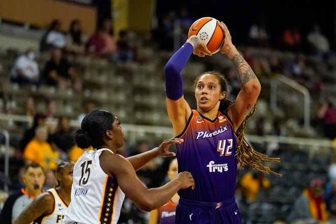Phoenix Mercury center Brittney Griner (42) shoots over Indiana Fever forward Teaira McCowan (15) in the first half of a WNBA basketball game in Indianapolis, Monday, Sept. 6, 2021. (AP Photo/Michael Conroy)