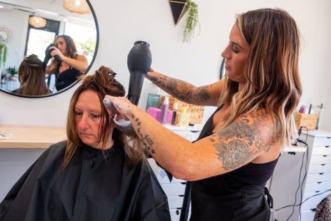 Ashlynn Vroman, co-owner of Black River Beauty Bar, gives Misty Gibson a haircut on Tuesday, Sept. 7, 2021, at the Port Huron salon.