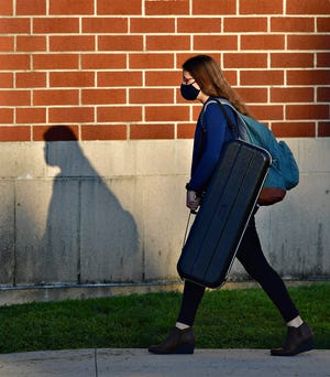 A student arrives at Central York High School in Springettsbury Township, Tuesday, Sept. 7, 2021. Dawn J. Sagert photo
