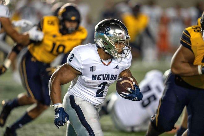 Nevada running back Devonte Lee (2) runs against the Cal defense at Memorial Stadium on Saturday.