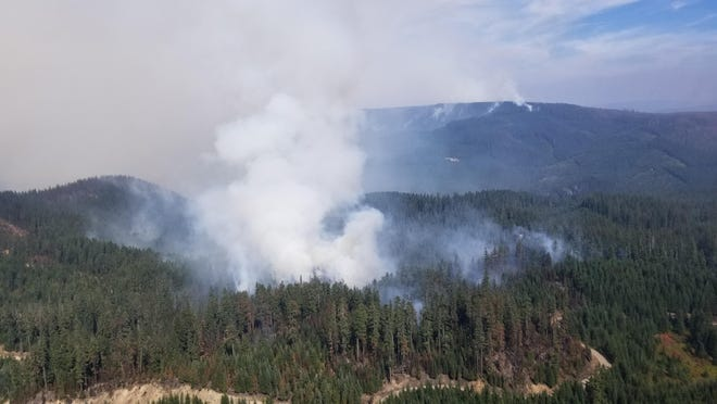 Smoke rises over the Bull Complex fire on Saturday, Sept. 4, 2021.