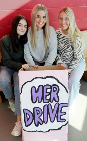 Three Sheboygan South seniors, from left, Ella Smith, 17, Elli Renzelmann, 17, and Isabella Dexter, 17, are making a difference in women's lives by helping collect feminine hygiene products for the Her Drive charity, Tuesday, September 7, 2021, in Sheboygan, Wis. Her Drive charity helps women of all ages who can't access or afford feminine hygiene products.