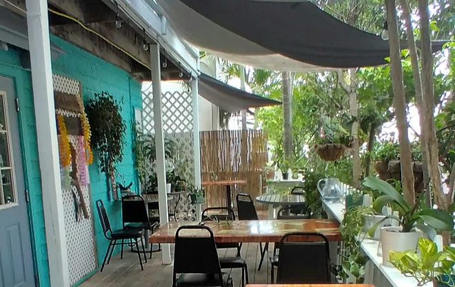Society Market Cafe has a lush shaded patio for outdoor dining.