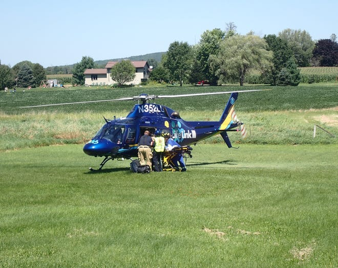 Helicopter ambulance airlifts a patient from a field in this file photo.