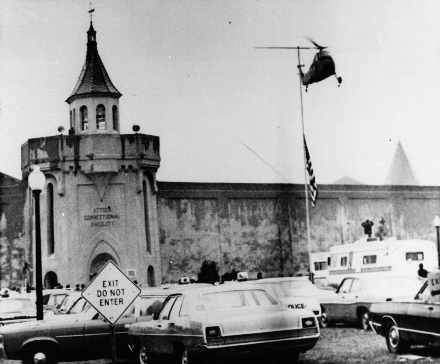 An Army helicopter makes a low pass over the Attica Correctional Facility on Sept. 13, 1971. Troops fired tear gas shells into the prison's D Yard, where inmates held 38 hostages.