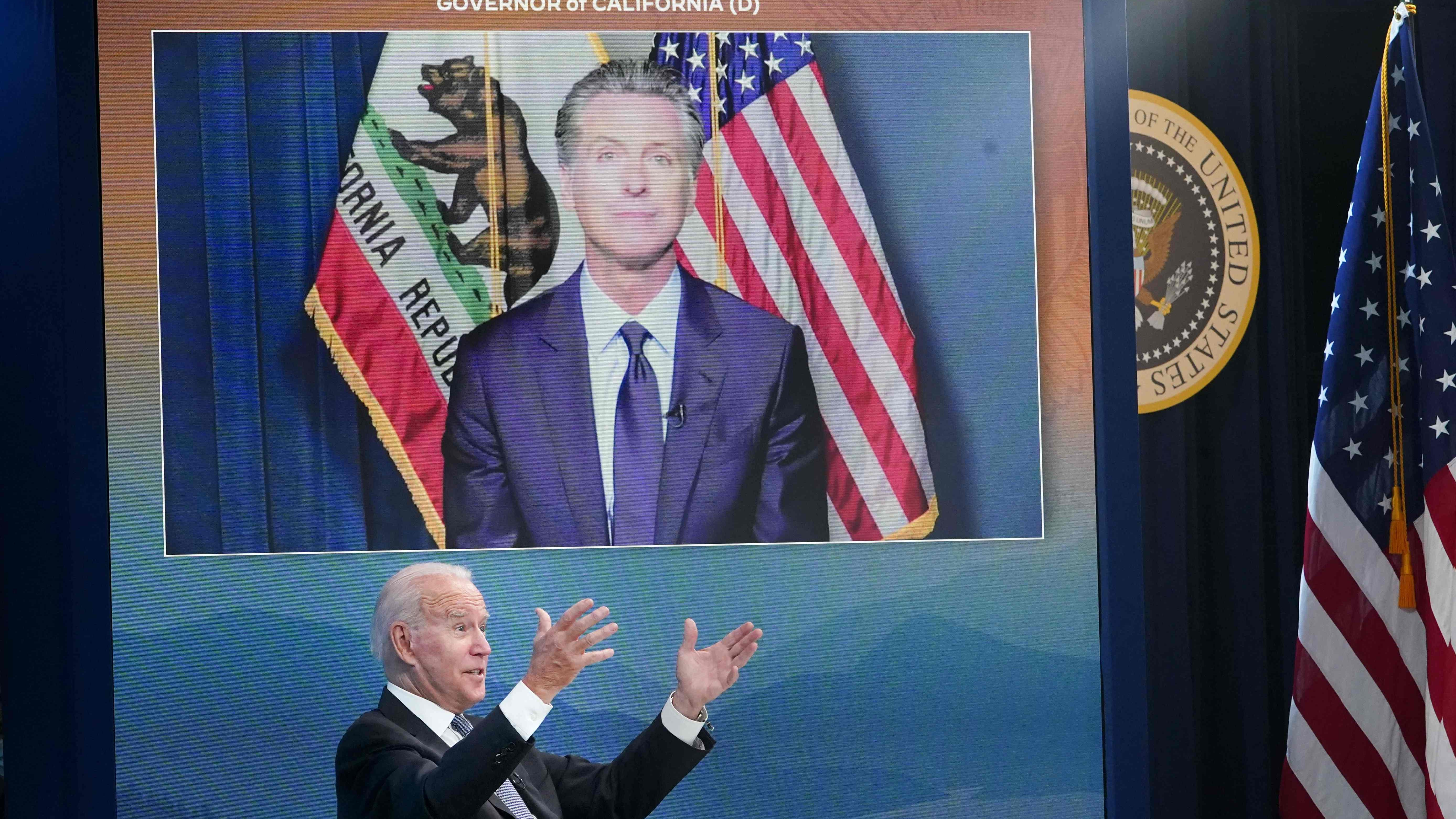 US President Joe Biden speaks as California Governor Gavin Newsom. on a screen, looks on during a meeting with state governors on wildfire prevention and preparedness in the South Court Auditorium of the Eisenhower Executive Office Building, next to the White House, in Washington, DC on July 30, 2021. (Photo by MANDEL NGAN / AFP) (Photo by MANDEL NGAN/AFP via Getty Images)