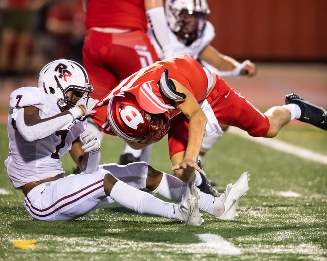 Round Rock's Travien Brown, left, sacks Belton's quarterback in the Dragons' 35-0 win last week. Round Rock, ranked No. 4 in the Statesman's Class 6A poll, debut at No. 25 in the state poll this week.