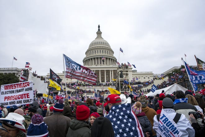Insurrectionists loyal to President Donald Trump rally at the U.S. Capitol in Washington on Jan. 6.  [AP PHOTO/JOSE LUIS MAGANA/FILE]