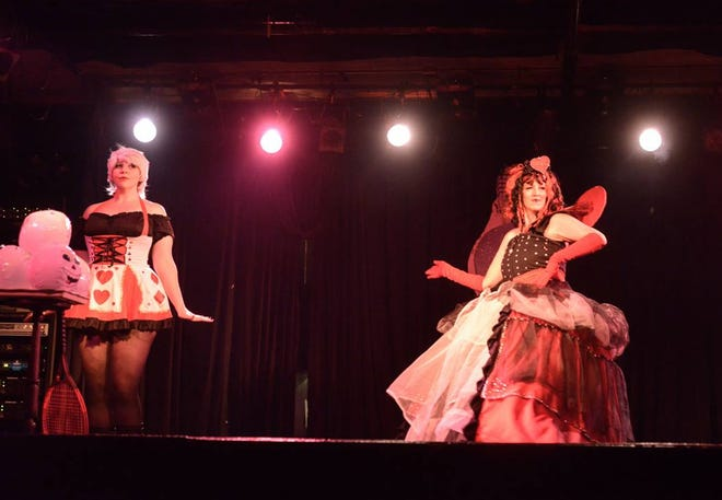 """In this undated photo, (L-R) Heather Christopherson """"Poppy Cox"""" and Deborah Purcell """"Misty Tetons"""" perfrom onstage during an Effie's Club Follies show at the 40 Watt Club."""