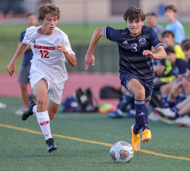 Hudson's Easton Rowell (3) beats Wadsworth's Austin Valentine (12) in a boys soccer game on Tuesday, Sept. 7, 2021. Hudson beat Wadsworth 3-1.