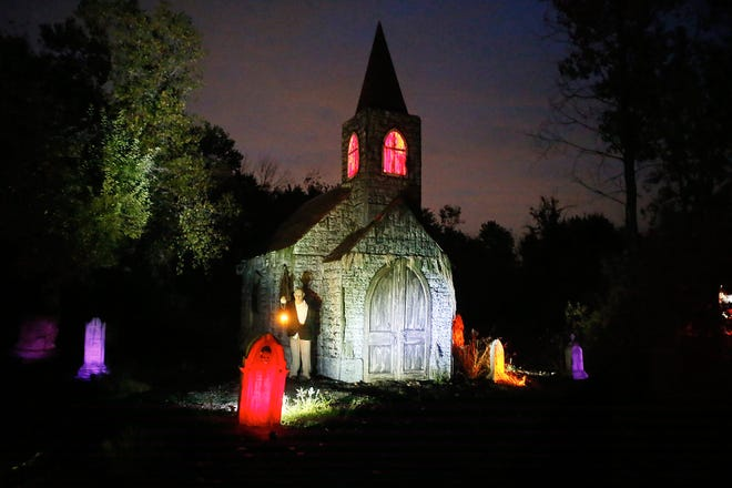 A cemetery scene greets visitors on a haunted hayride at the Forest of Screams in Sharon Township in 2017.
