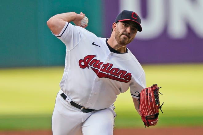 Cleveland starter pitcher Aaron Civale delivers in the first inning a 3-0 loss to the Minnesota Twins on Tuesday night at Progressive Field. [Tony Dejak/Associated Press]