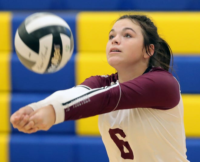 Woodridge's Catie Patterson bumps the ball back over the net during the first set of a volleyball match at Coventry High School, Tuesday, Sept. 7, 2021, in Coventry Township, Ohio.