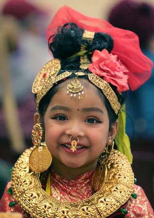 Dipsane Baraily, 4, with her traditional Nepali dance outfit, at the Himalayan Arts Language & Cultural Academy New Year's celebration at Jennings CLC in January 2020. Students from the academy will perform dances and songs derived from Karen, Nepali, Indian, Latino and American culture this Saturday during the North Hill Music Festival.