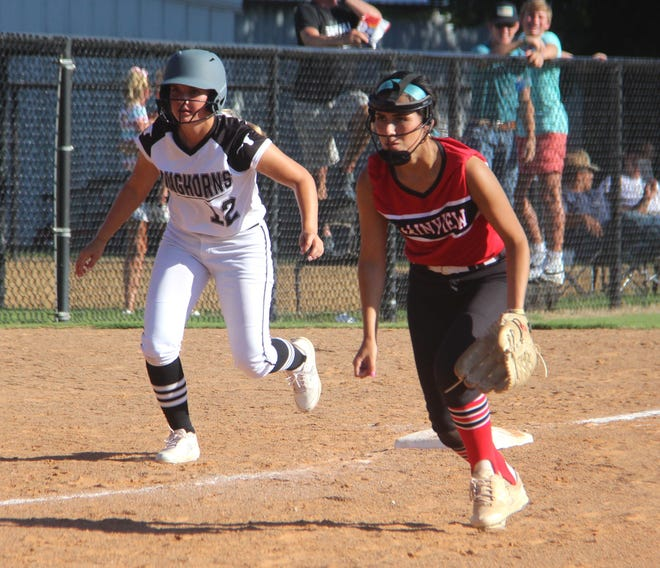 Lone Grove's Logan Ketchum, left, takes a lead off of third base as Plainview's Dalia Daniels sets up on defense earlier this season. The two squads meet again in a pivotal District 4A-3 contest on Tuesday, Sept. 14 in Plainview.
