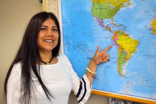 Fredesbinda Granda points to Peru on a map at the Ardmore Public Library. She moved to the United States eight years ago and has since become an American citizen thanks to free classes for English and citizenship offered at the library.
