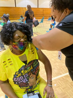 Jacqueline Lockhart, 65, of Augusta gets her second shot of Pfizer vaccine from public health nurse Ashly Adams at May Park Community Center during a kick-off of the City of Augusta's vaccination program that includes $100 gift cards for those who got fully vaccinated.