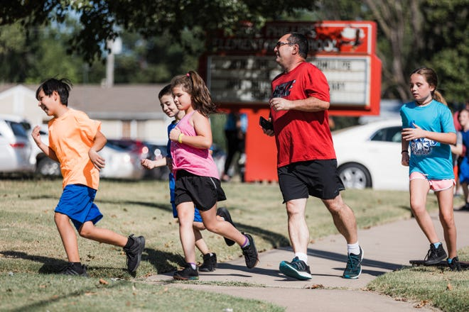 Jane Phillips Elementary Principal Kevin Brown runs with fifth-graders after school every Monday, Wednesday and Friday as part of the Bruins on the Run program.