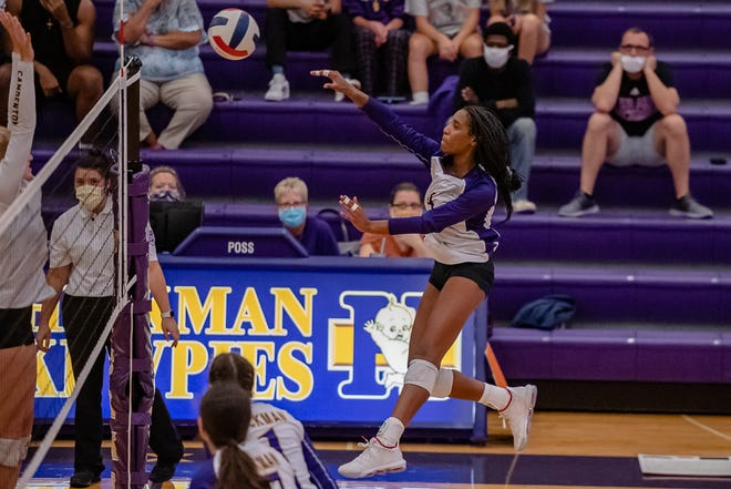 Hickman's Jerica Jackson goes up for the spike attempt