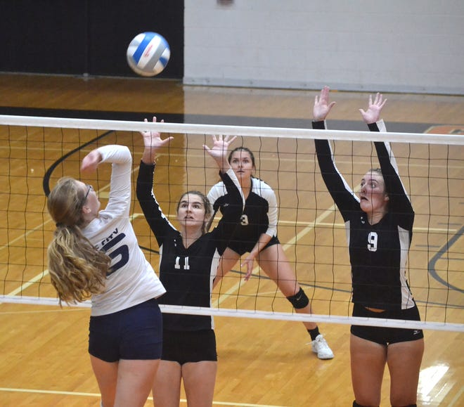 Cheboygan's Lia Basanese (11) and Kyla Thater (9) go up to block a kill attempt from Boyne City's Morgan Deming, left, during the third set of a non-conference varsity volleyball matchup in Cheboygan on Tuesday.