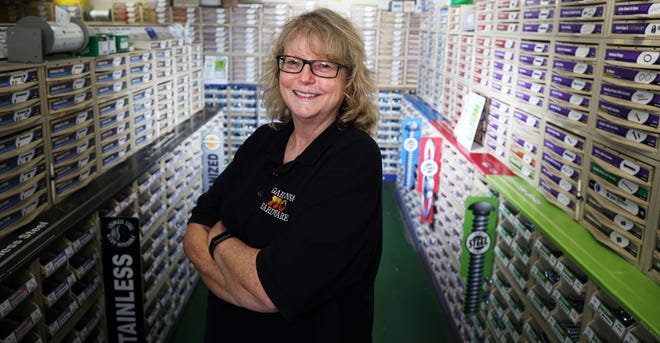 Twyla Edgell, owner of Gahanna Hardware, stands in an aisle featuring a variety of nuts, bolts, screws and other fasteners. The store carries many items that aren't easily found in big-box stores.