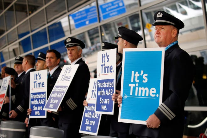 American Airlines first officer Ken Abernathy, right, joined pilots representing the Allied Pilots Association in rallying for a new contract in January 2020. AA pilots plan to picket this fall over fatigue and poor working conditions.