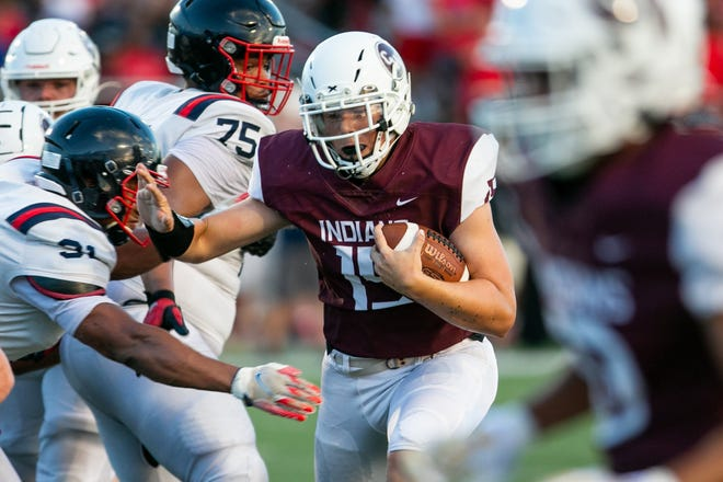 """Canal Winchester quarterback Reece Musick has been attempting to balance his role as a game manager and a playmaker. """"My job is to make sure the offense runs smoothly, get the run going and take shots over the top when we can,"""" he said."""