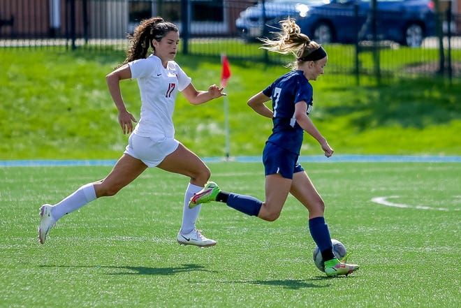 Columbus School for Girls' Annie Wagenbrenner (left) pursues Wellington's Eva Dulle during the Unicorns' 3-0 win Sept. 4 in their MSL-Ohio opener. Wagenbrenner is a key contributor to a defense that allowed five goals through CSG's first five games.