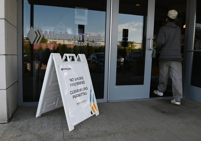 Businesses have been updating their mask policies as the delta variant surges. This sign was outside Michigan First Credit Union on Sept. 1 in Eastpointe, Michigan. The credit union cites security issues in its policy, has shifted to clear masks only.