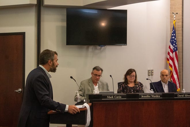 Matt Long speaks to council about rezoning property from traditional residential to community commercial for new parking.