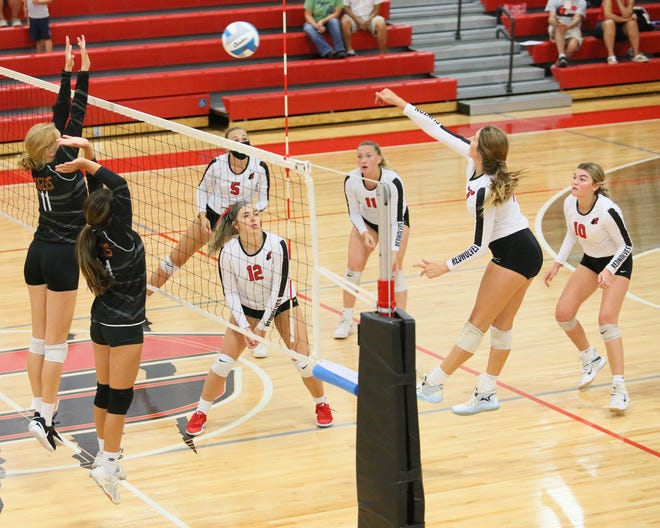Clinton's Kaylee Kranz goes up for a kill during Tuesday's match against Hudson.