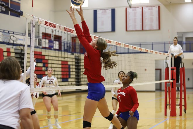 Dodge City High School senior Mataya Clark attempts a block while senior Kya Edwards looks on during their varsity volleyball game against the Great Bend Panthers on Sep. 7. The Demons lost 1-3 to the Panthers. Their next varsity game will be on Sep. 9 at the Fieldhouse.