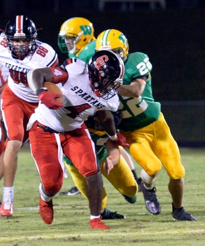 Central Davidson's Nyzaiha White tries to shake off a West Davidson tackler. [Mike Duprez/The Dispatch]