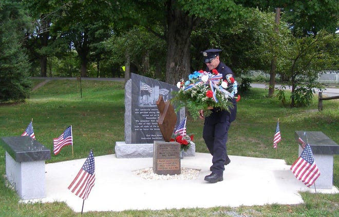 Robert Essex, a retired New York Port Authority policeman, lays flowers at the 9/11 Memorial in Hawley in 2012. The public is welcome to the 20th anniversary ceremony in Bingham Park at 10 a.m., Saturday, September 11.