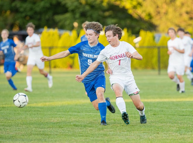 Hornell's Liam Khork fights for possession of the ball on Tuesday evening during a contest with Haverling in Bath.