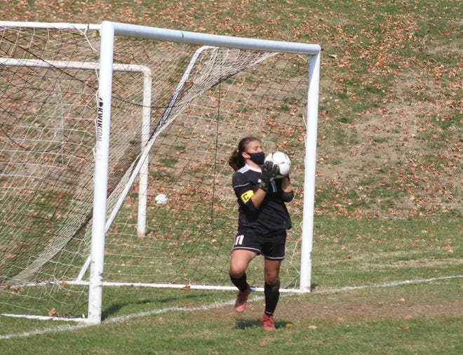 Hornell's Juliet Marino makes a save during a contest in Bath last season for the Red Raiders.