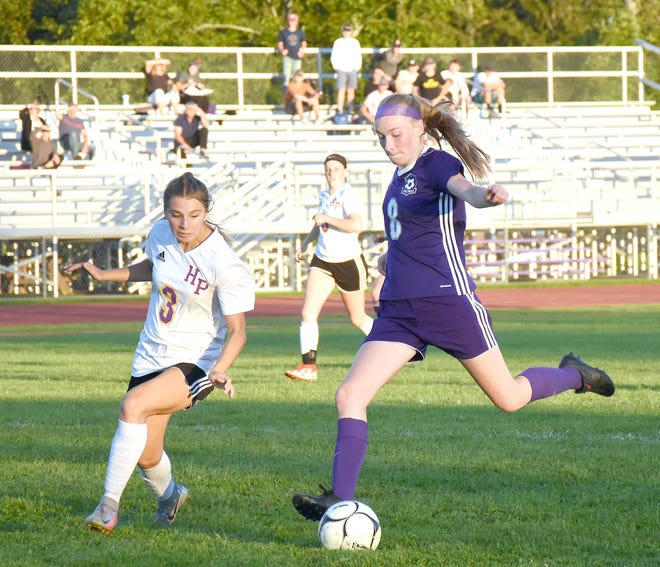 Shayna Straney steps into the shot that produced the third of her four goals for Little Falls Tuesday during the Mounties' 5-4 come-from behind 5-4 victory over Holland Patent.