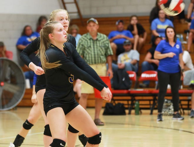 Wapello sophomore Emily Hemphill returns a serve in the Arrows' 3-1 win over the Wolves at Winfield.