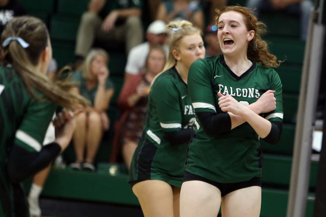 West Burlington High School's Sophia Armstrong (19) celebrates a point during their match against WACO Tuesday Sept. 7, 2021, at West Burlington.