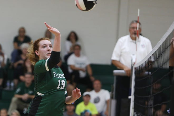 West Burlington High School's Sophia Armstrong (19) puts the ball over the net during their match against WACO Tuesday Sept. 7, 2021, at West Burlington.