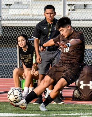 Garden City High School's Miguel Bustos moves the ball upfield to a teammate during a game Aug. 31 at Buffalo Stadium.