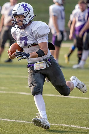 Knox College junior Kendall Ballman looks upfield as he runs with the ball during football practice on Tuesday, Sept. 7, 2021 at the Knosher Bowl.