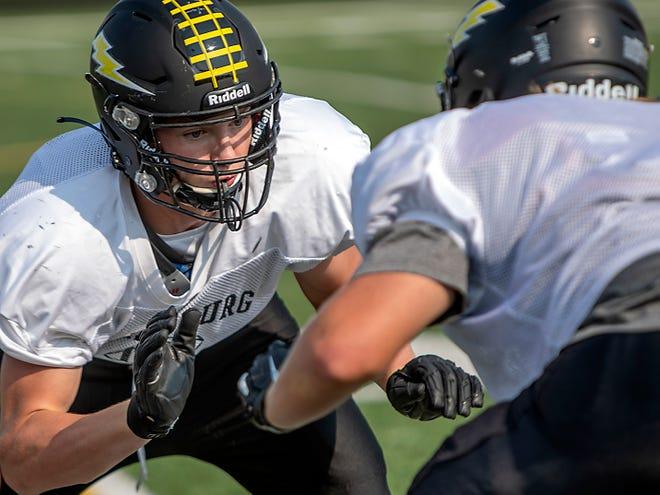 Galesburg High School sophomore Xavier Van Dyke prepares to block during a drill at football practice on Tuesday, Sept. 7, 2021 at Van Dyke Field.
