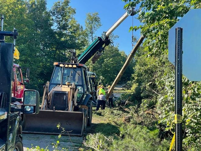 Power crews with Hillsdale and Coldwater's Boards of Public Utilities work to replace a power pole on Lake Wilson Road near Bankers Road Wednesday morning.