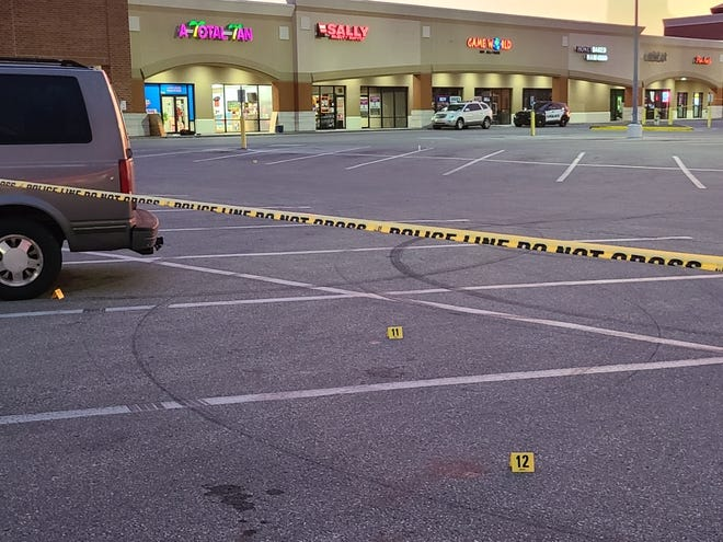 Police tape marks the scene of a shooting Tuesday, Sept. 7, 2021.