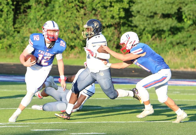 West Henderson quarterback Truitt Manuel breaks away for a big gain during West's season opener against Chase at West.